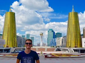 Standing in front of Astana's futuristic landscape, a highlight of my backpacking journey