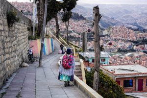 A local women walking around a neighborhood in La Paz, make sure to be careful and stay safe when backpacking around South America