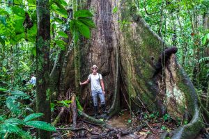 With a huge tree during the Amazon tour