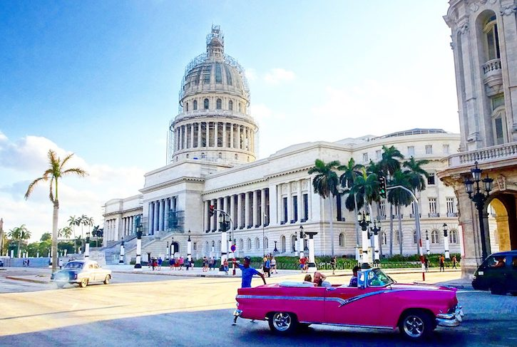 The capitol of Havana with a nice retro car in front