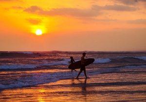 Bali Canggu with surfers at sunset