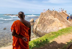 Coast with monk in Galle