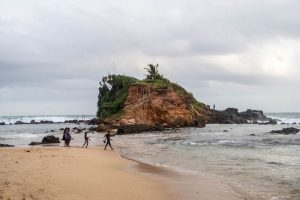 Rock on the cloudy beach while backpacking southern Sri Lanka