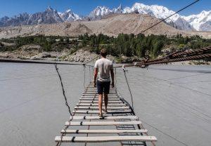 Crossing the Hussaini Suspension Bridge