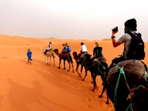 On a camel in the desert in Morocco