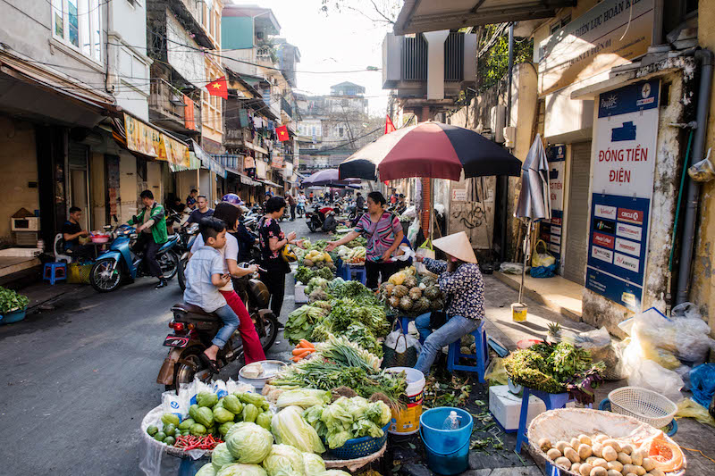 Busy market streets when backpacking Hanoi