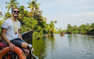 Cruising on a river on my backpacking Kerala trip
