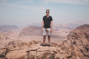 Standing in stone desert when backpacking Jordan