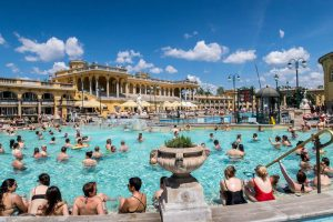 Thermal bath outside with lots of people