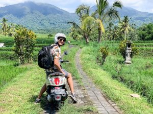 On a scooter in the rice fields