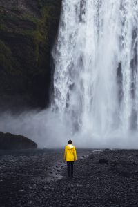 Person in front of waterfall in Iceland